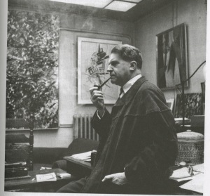 Georges Duthuit in his studio at 96 Rue de l'Université in 1962. Behind him paintings by Jean-Paul Riopelle, Nicholas de Staël and Henri Matisse.