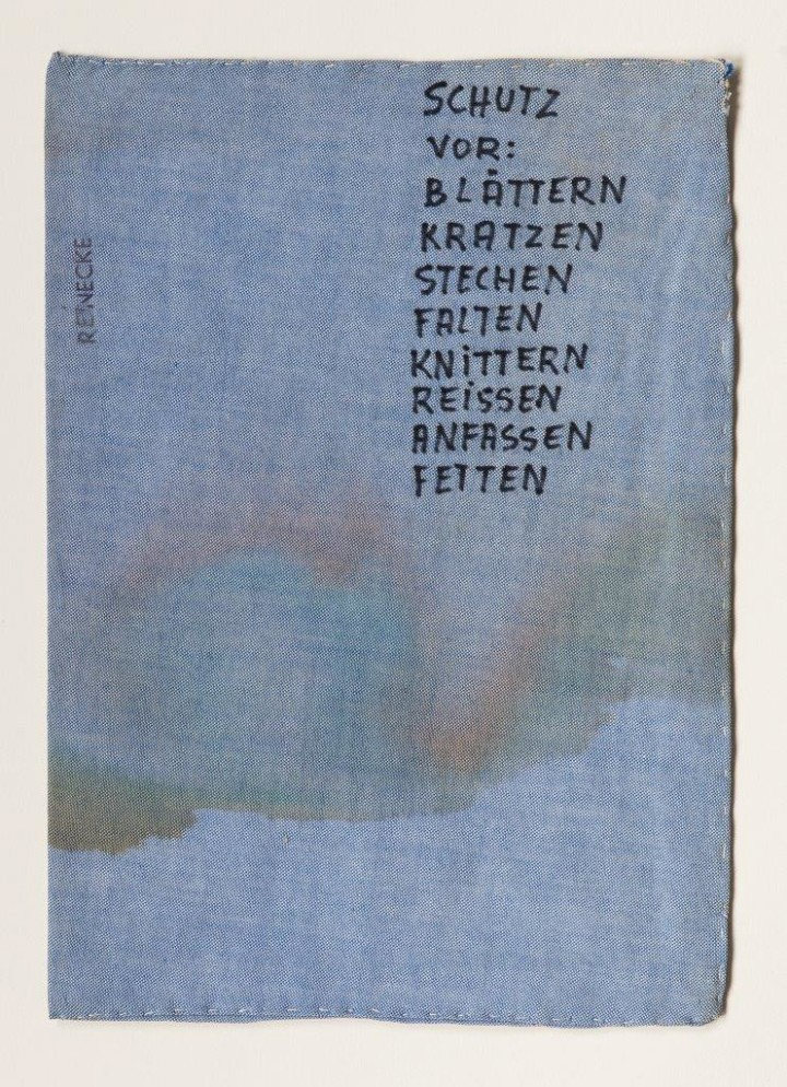 Chris Reinecke, Schutz vor: Blattern Kratzen Stechen Falten Knittern Reissen Anfassen Fetten, 1969, Jeans fabric stamped and written on with felt-tip pen, lined with white yarn, paper inlay, 12 by 8 1/2 inches.